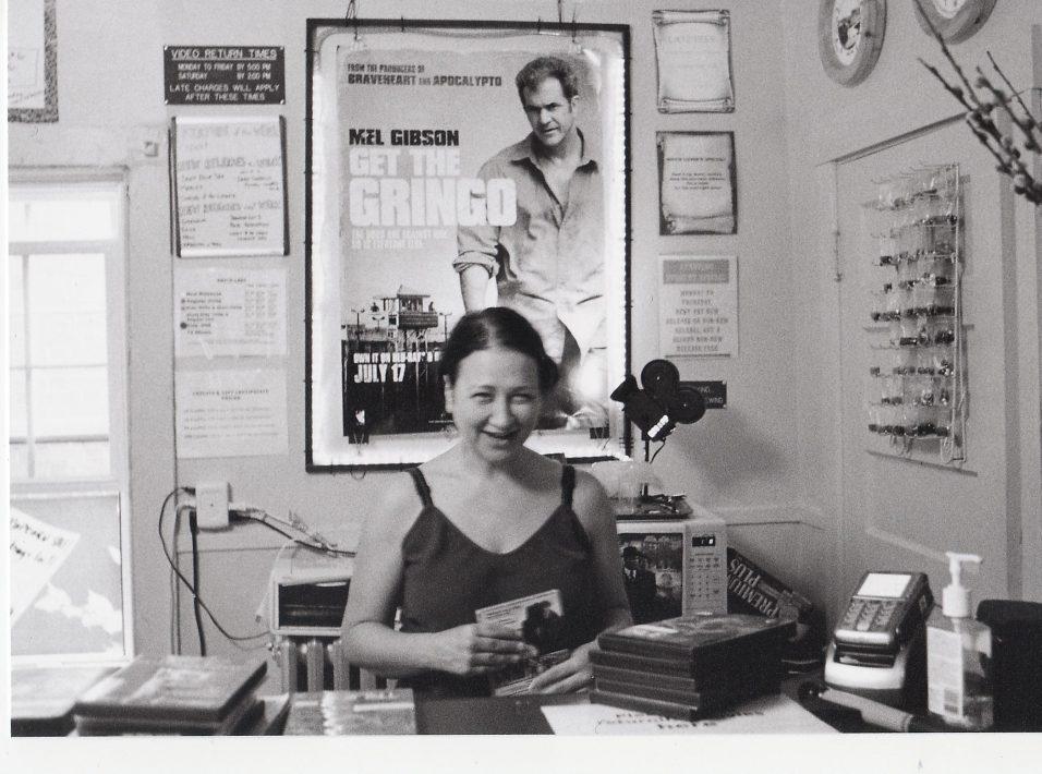 Cinematopia___megan_behind_desk
